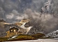 Dramatic dusk. Storm os coming. Passe Rolle Dolomites Italy